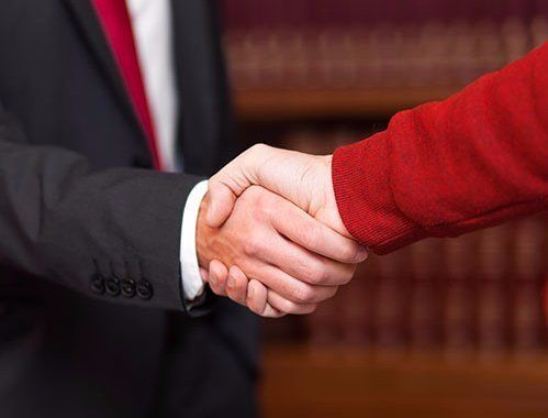 Lawyer and client shaking the hands