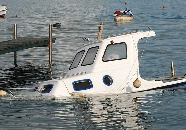Sunken boat near the pier