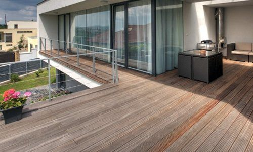 wooden deck with steel railing