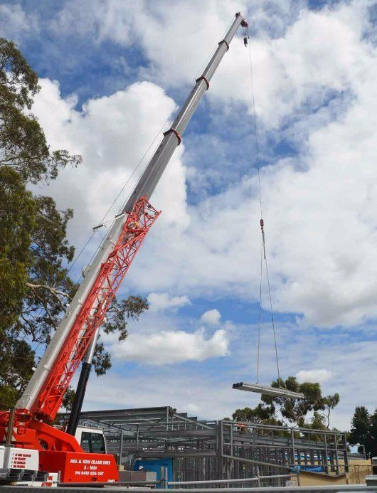 crane lifting construction supplies