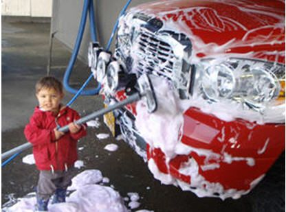 Child showing how easy it is to use the car wash