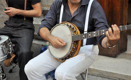 man playing banjo
