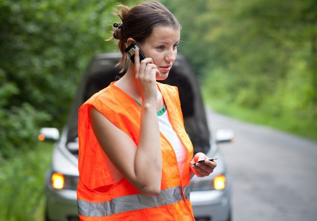 woman on road calling for roadside assistance and auto repairs in Carthage, OH