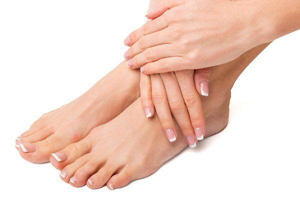 woman holding beautiful feet