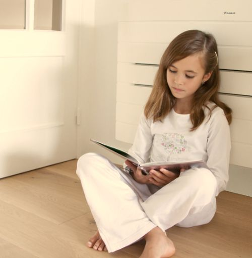 Girl reading comfortably under Air conditioner