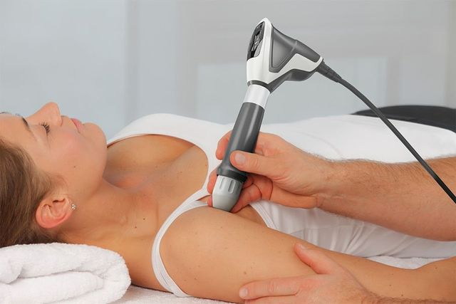 client having shock wave therapy