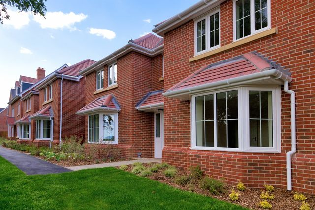 A row of newly built red brick houses