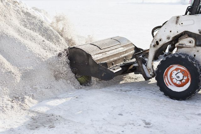 snow plow creating a large pile of snow