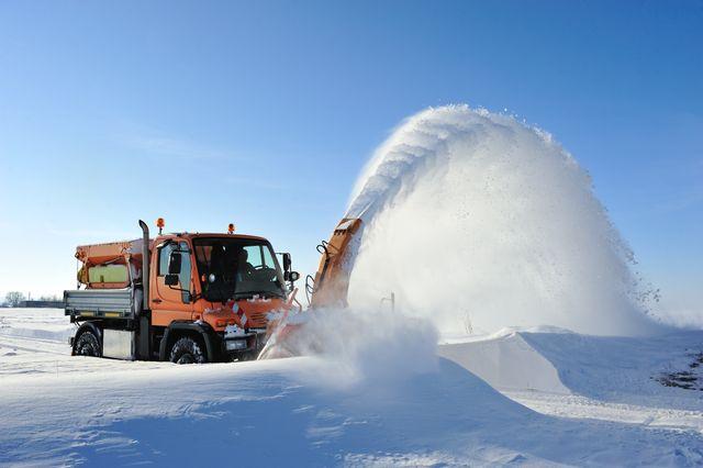 truck redistributing snow