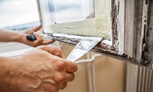 Professional repairing window's wooden frame