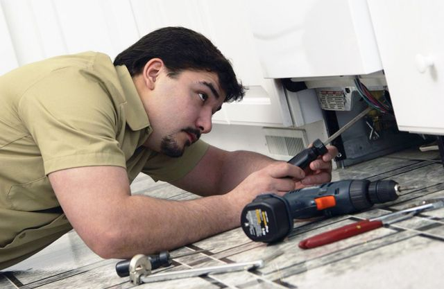 Man working on an appliance service in Auckland and the North Shore