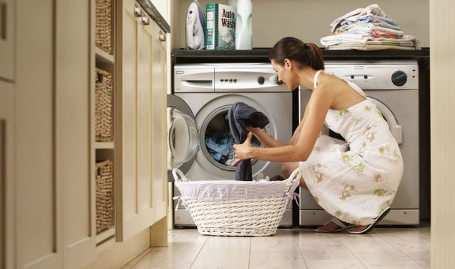 A lady in Auckland does her laundry thanks to an electrical repair