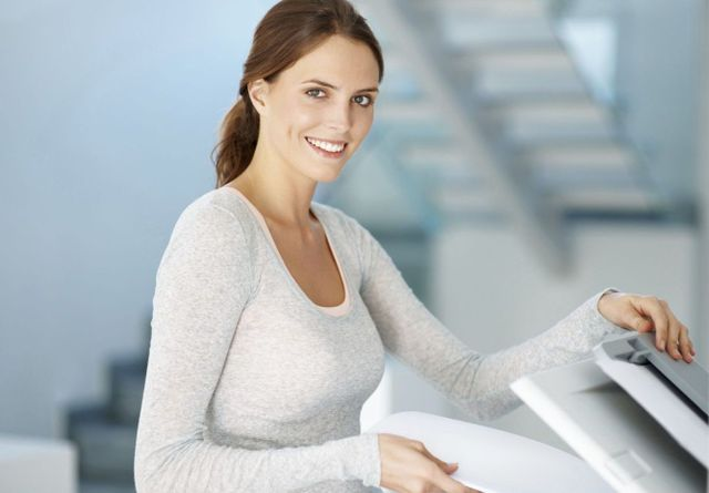 Woman making copies because of our print solutions in Auckland