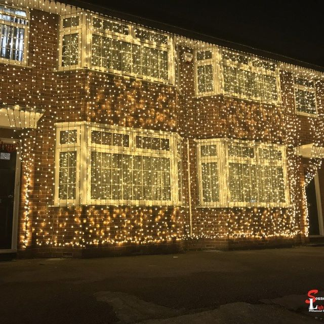 A Huge House Completely Lit Up In Lights