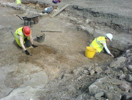 2 men working at an archaeological project