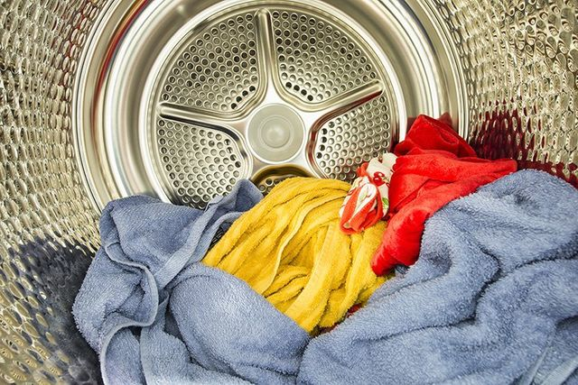 Interior view of tumble dryer with drying clothes
