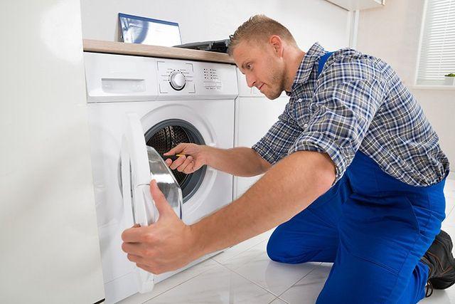 Technician repairing the washing machine
