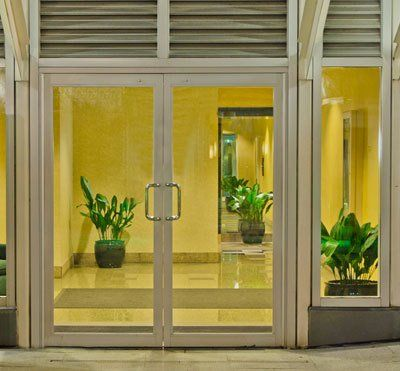 An glass entrance door to a lavish office