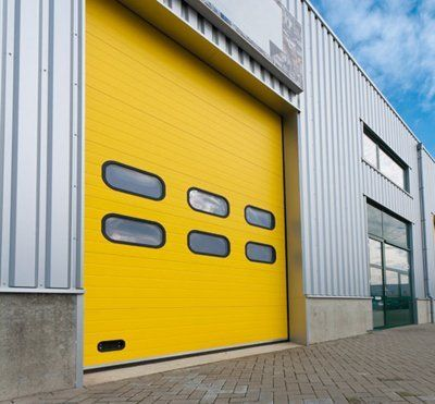 A yellow industrial garage door from GT Automation