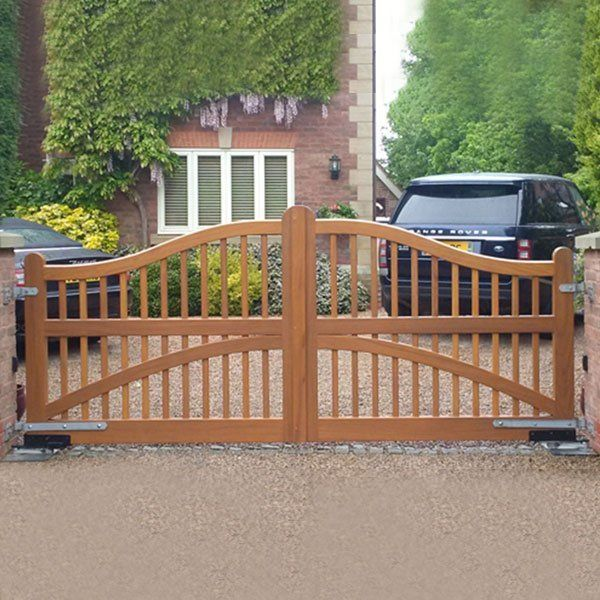 A closed automatic wrought iron gate to a domestic driveway