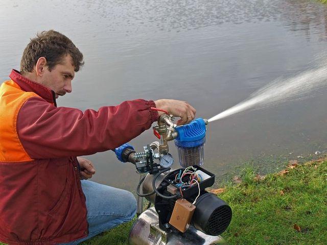Electrician repairing the water pump