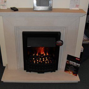 coal effect electric fire in white surround