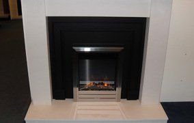 glass fronted fireplace and granite hearth