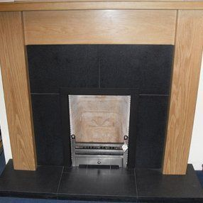 multi fuel fire in simple wood surround