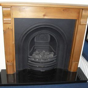 cast iron fireplace in wood surround