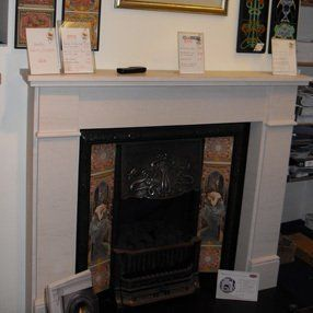 tiled fireplace with white surround