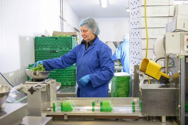 A lady measuring veggies
