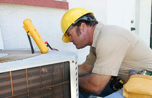 Expert repairing an air conditioner