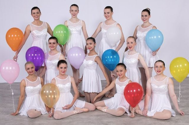 group of dancers with balloons