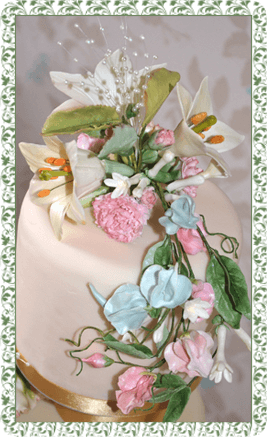 one of our stunning wedding cakes in pink with sugar flowers