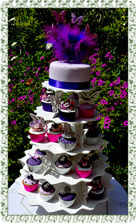 tall celebration cake with cup cakes in tiers