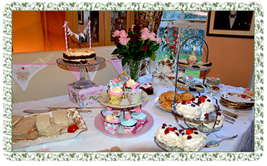 table groaning under scrumptious cakes