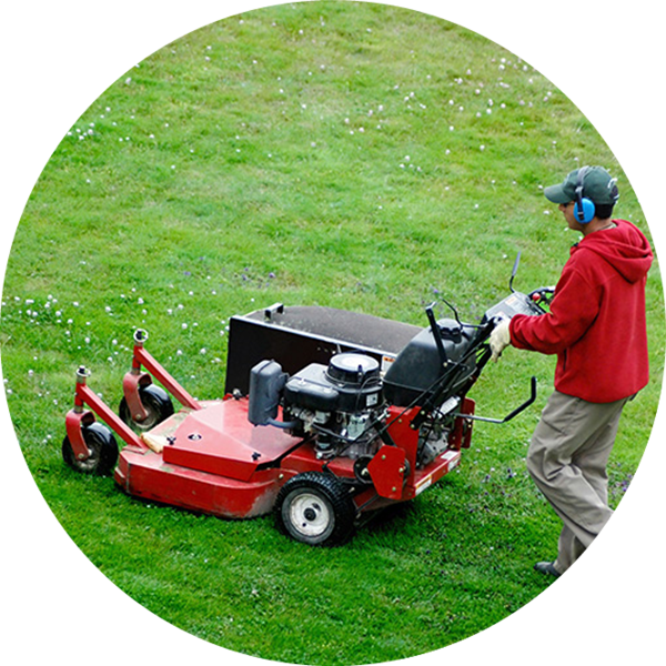 Man moving the lawn cutter