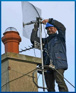 Man installing an aerial