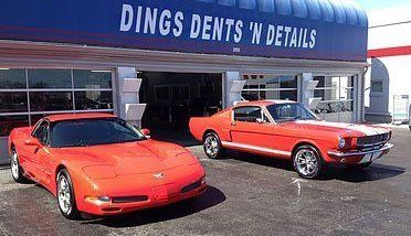 Cars in the front of the detailing office in Lexington