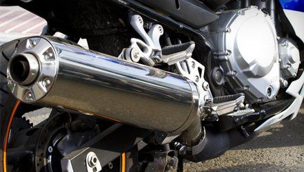 Shiny motorcycle exhaust tail pipe