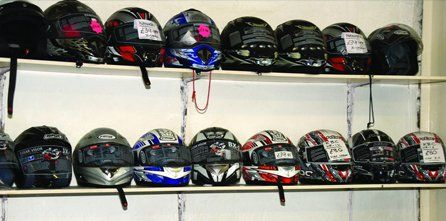 a selection of motorcycle helmets