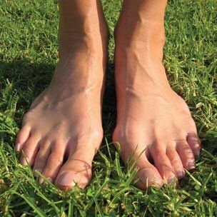 Feet on grass — Foot and Ankle Surgeons in New York, NY