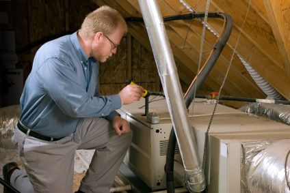 Experienced professional repairing the appliance