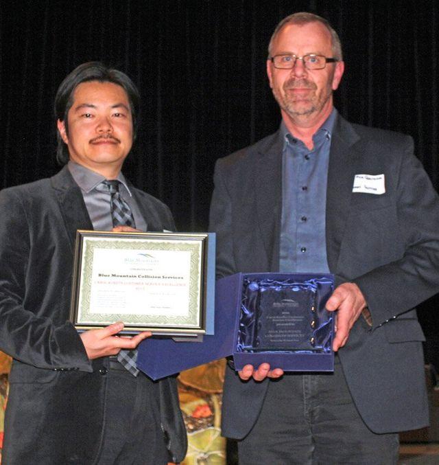 Albert Hutten accepting Customer Service award