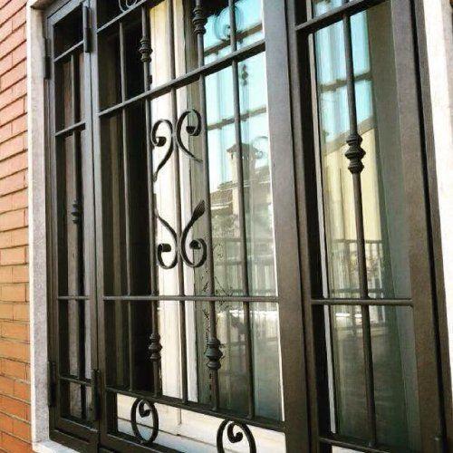 inferriate in ferro battuto per finestra di casa