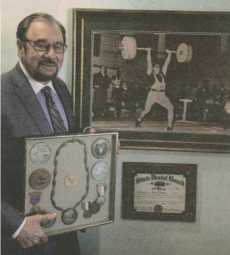 Dentist Dr. James George with Olympic Medals