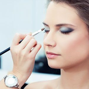 Applying makeup at beauty salon
