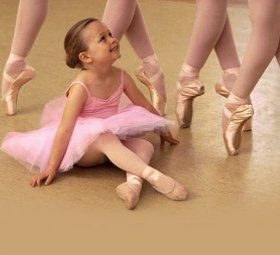 a small kid getting ready to dance