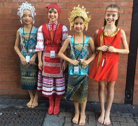 4 girls posing with dancing costume