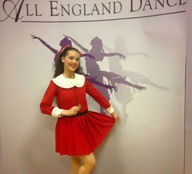 a lady in red dance costume
